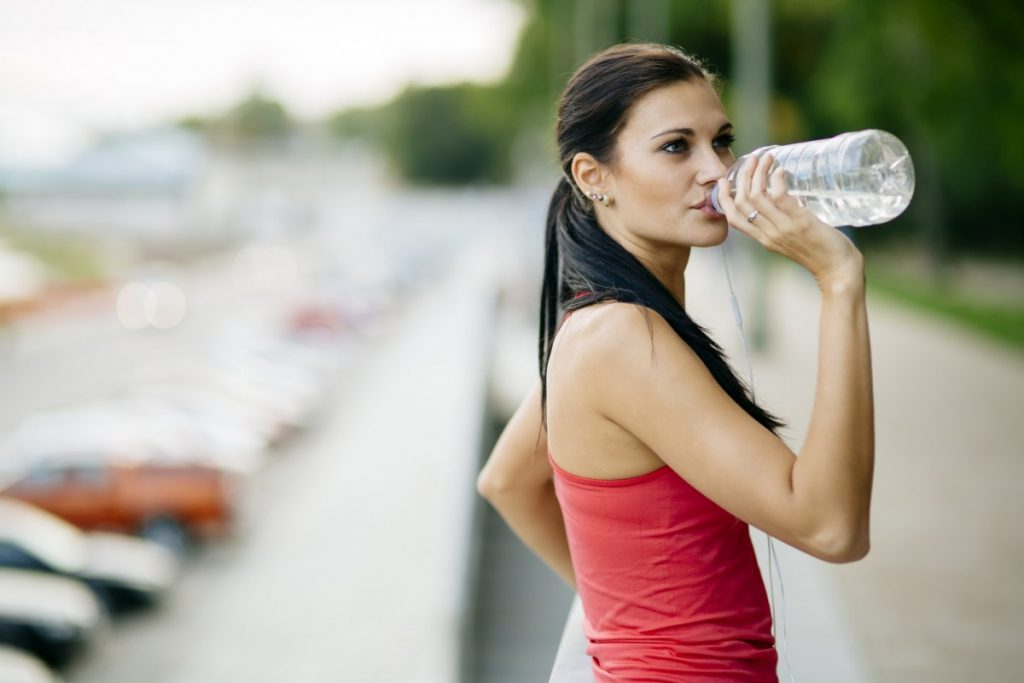 13 Ways To Look 10 Years Younger Naturally Without Costing The Earth; Attractive woman drinking water