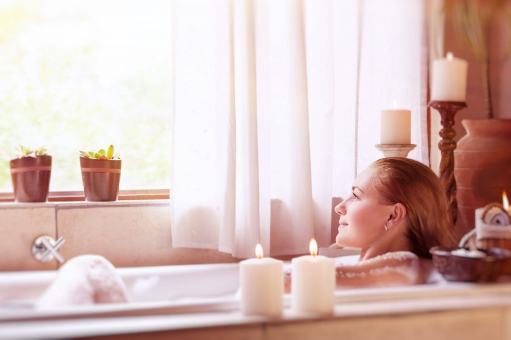 25 Incredible Benefits Of A Spa (Day, Treatments, Tub, Pool); Beautiful girl in the spa hotel