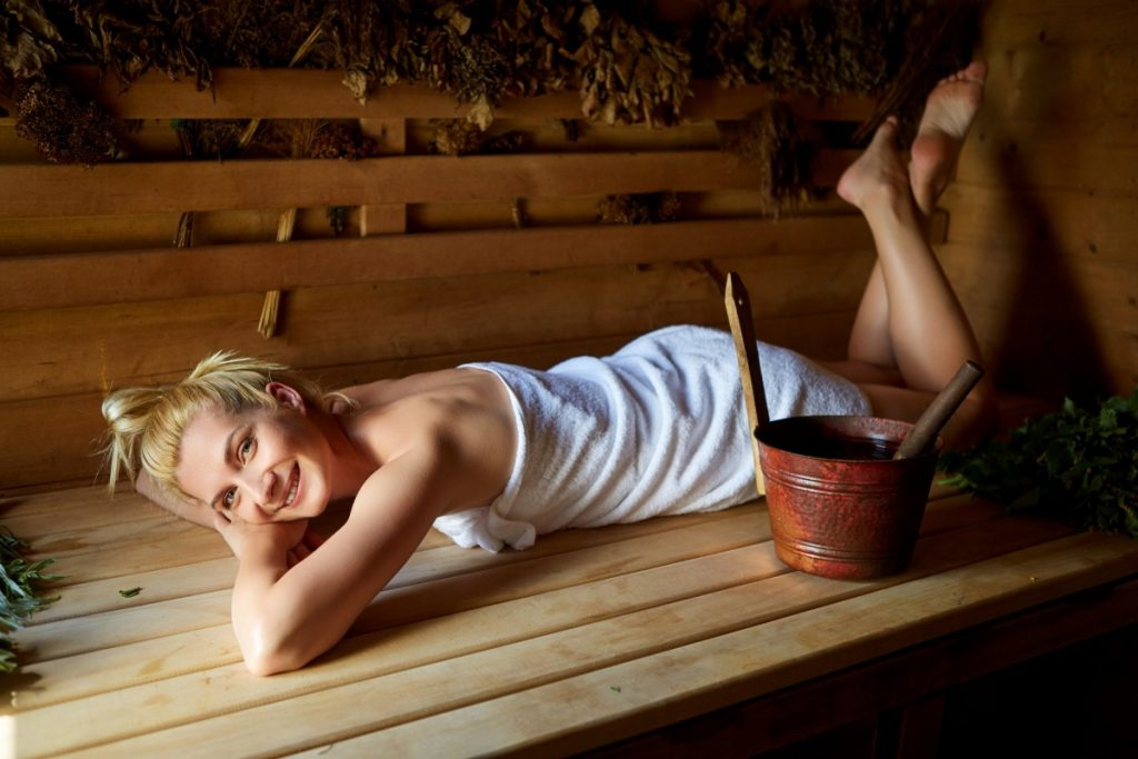 Do Portable Saunas Really Work? I've Never Felt Better; beautiful girl relaxing in sauna