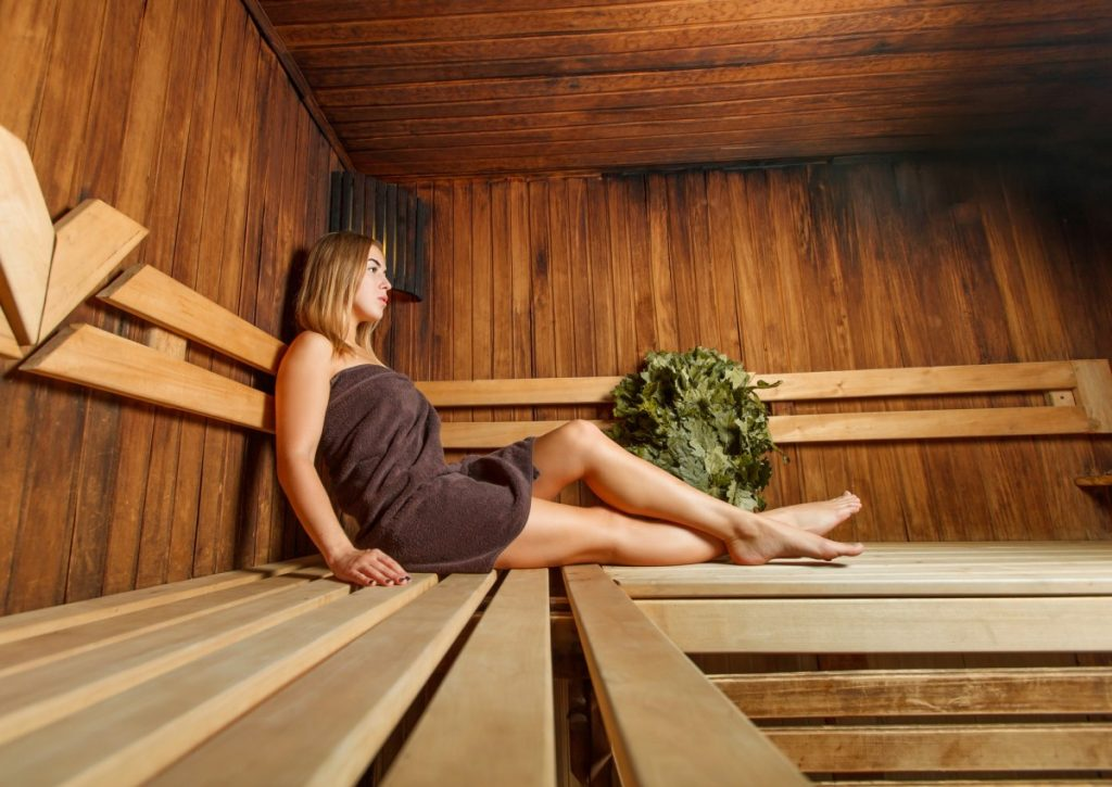 How Infrared Sauna Weight Loss Actually Works: This Is Genius; Beautiful woman takes relaxation in the sauna.