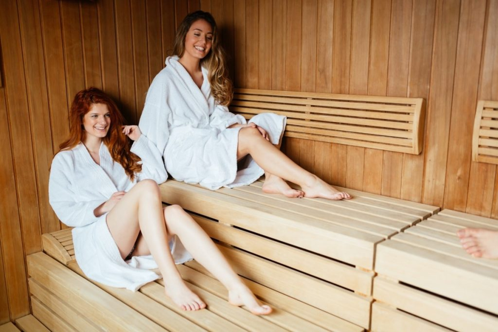 How Infrared Sauna Weight Loss Actually Works: This Is Genius; Beautiful women enjoying sauna treatment