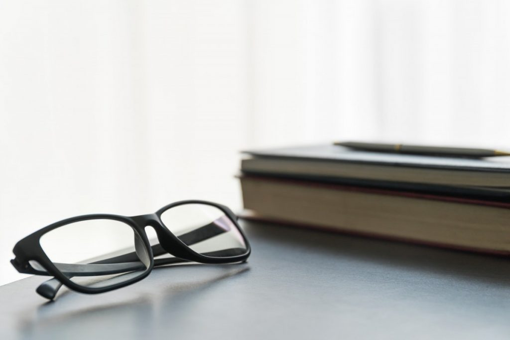 Do Portable Saunas Really Work? I've Never Felt Better; Glasses and book on the desk