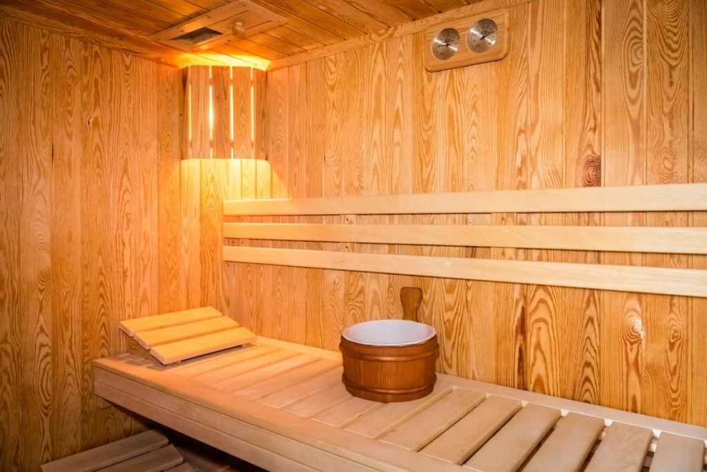 How Infrared Sauna Weight Loss Actually Works: This Is Genius; Interior of a wooden bed in a home sauna