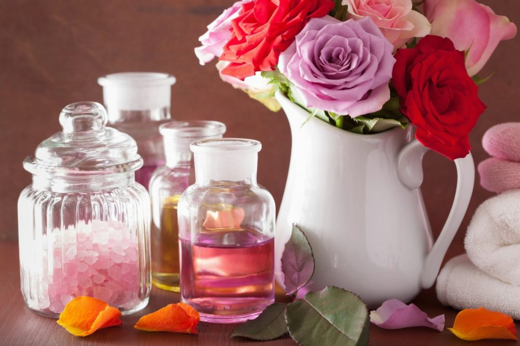 23 Ways To Make A Luxurious DIY Home Spa Bath On A Budget; spa aromatherapy with rose flowers essential oil salt