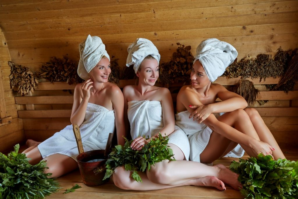 How Infrared Sauna Weight Loss Actually Works: This Is Genius; three girls relaxing in sauna