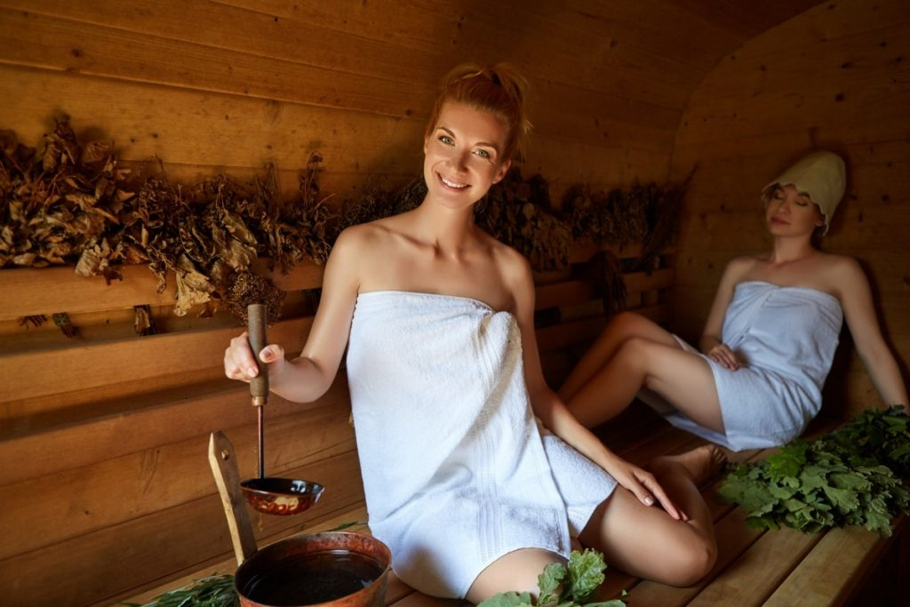 How To Have The Best At Home Spa Day: 25 Genius Ideas; two girls relaxing in sauna