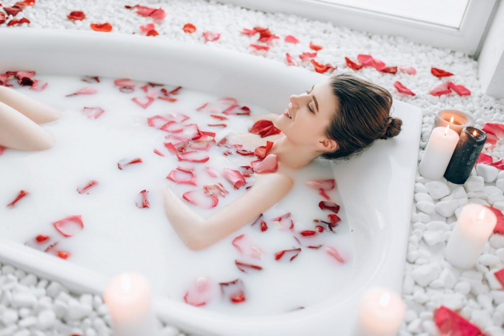 How To Have The Best At Home Spa Day: 25 Genius Ideas; Woman sleeps in the bath with foam, rose petals