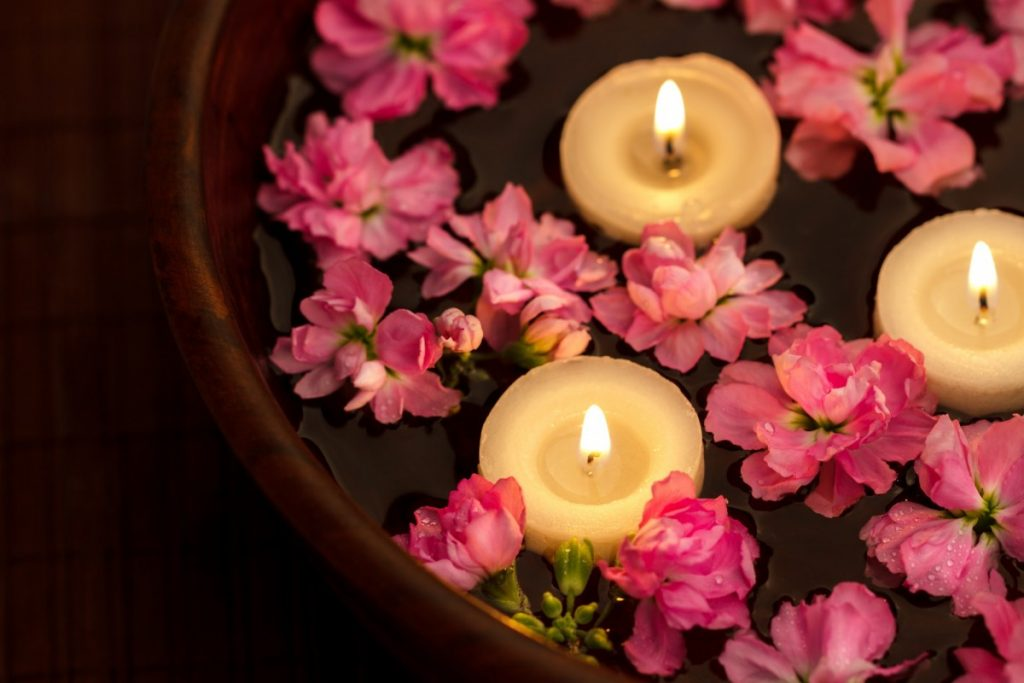 How To Have The Best At Home Spa Day: 25 Genius Ideas; Floating candle and flowers