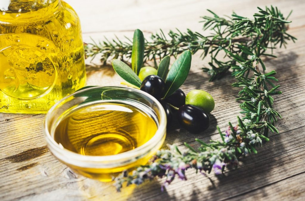 4 Best DIY Tanning Oil Recipes: Natural Protection With SPF; Olive oil with leaves and olives
