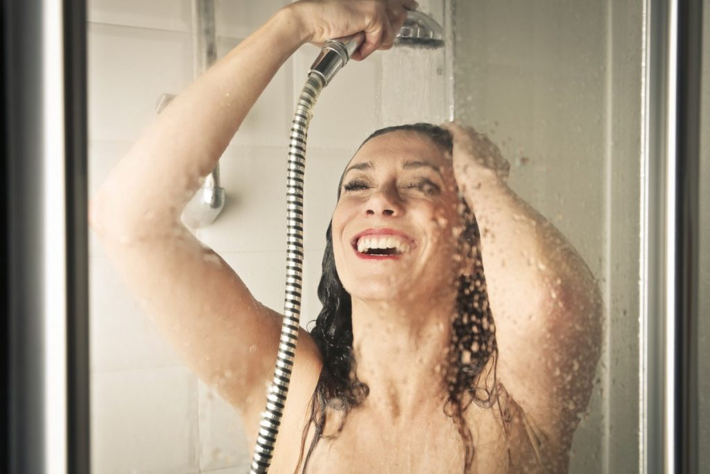 How To Have The Best At Home Spa Day: 25 Genius Ideas; Woman in a shower