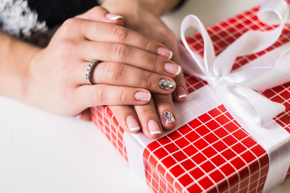 25 DIY Spa Gifts That Show How Much You Care; Beautiful gel lacquer. French manicure with silver diamonds