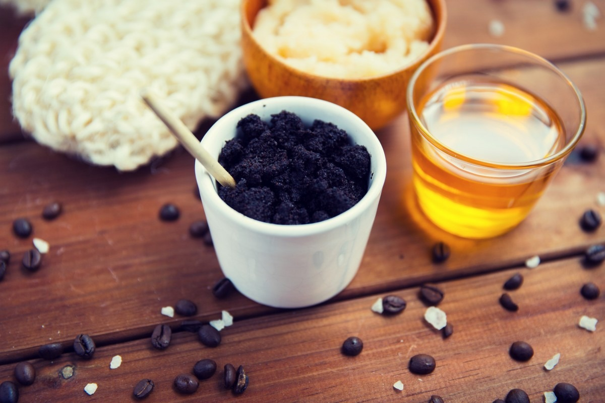 25 DIY Spa Gifts That Show How Much You Care; close up of coffee scrub in cup and honey on wood