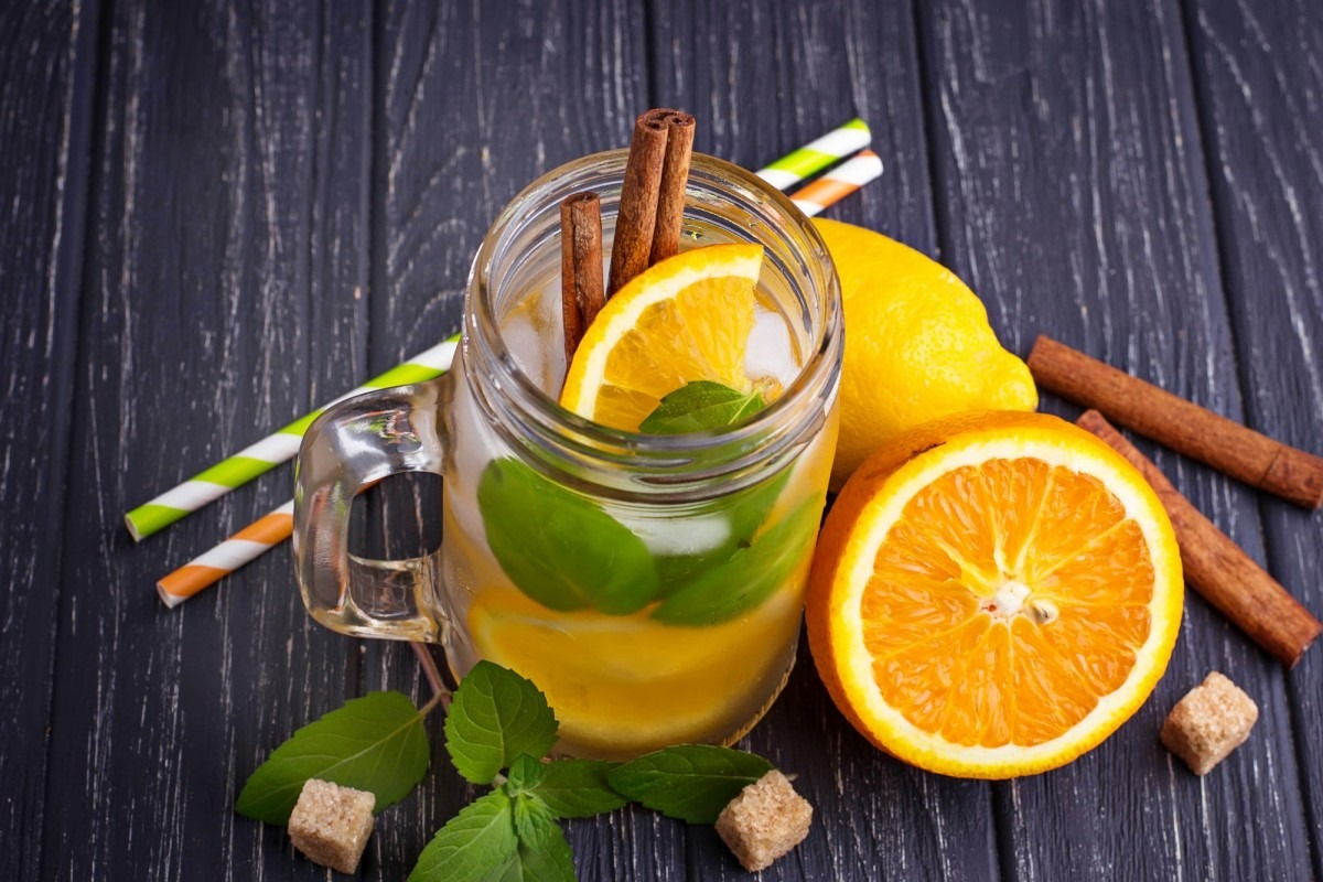 21 Invigorating Spa Water Recipes For Instant Energy; Detox water with orange, mint and cinnamon in jar