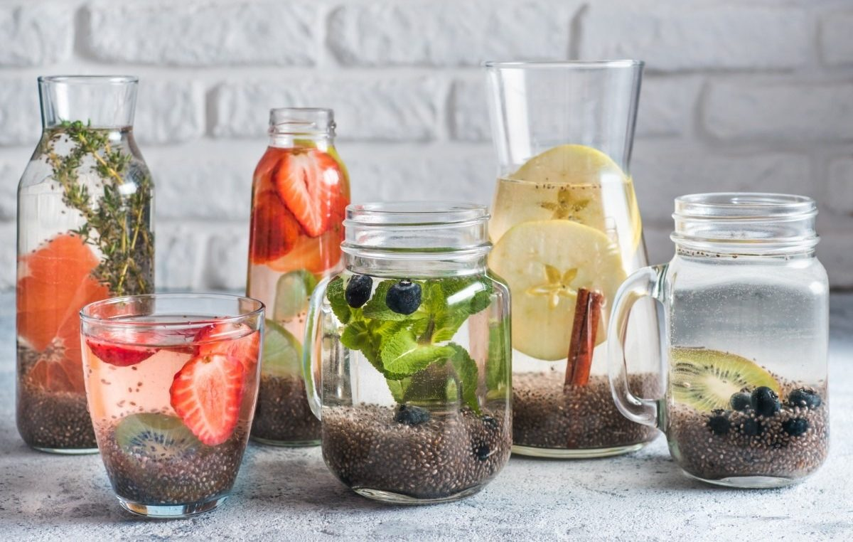21 Invigorating Spa Water Recipes For Instant Energy; Differnet chia water in glass, copy space