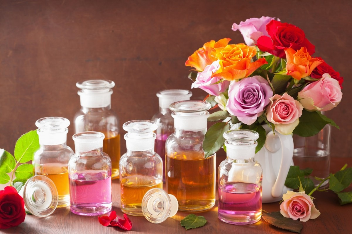25 Easy DIY Spa Recipes That Will Make You Look 10 Years Younger; Essential oil and rose flowers aromatherapy spa perfumery