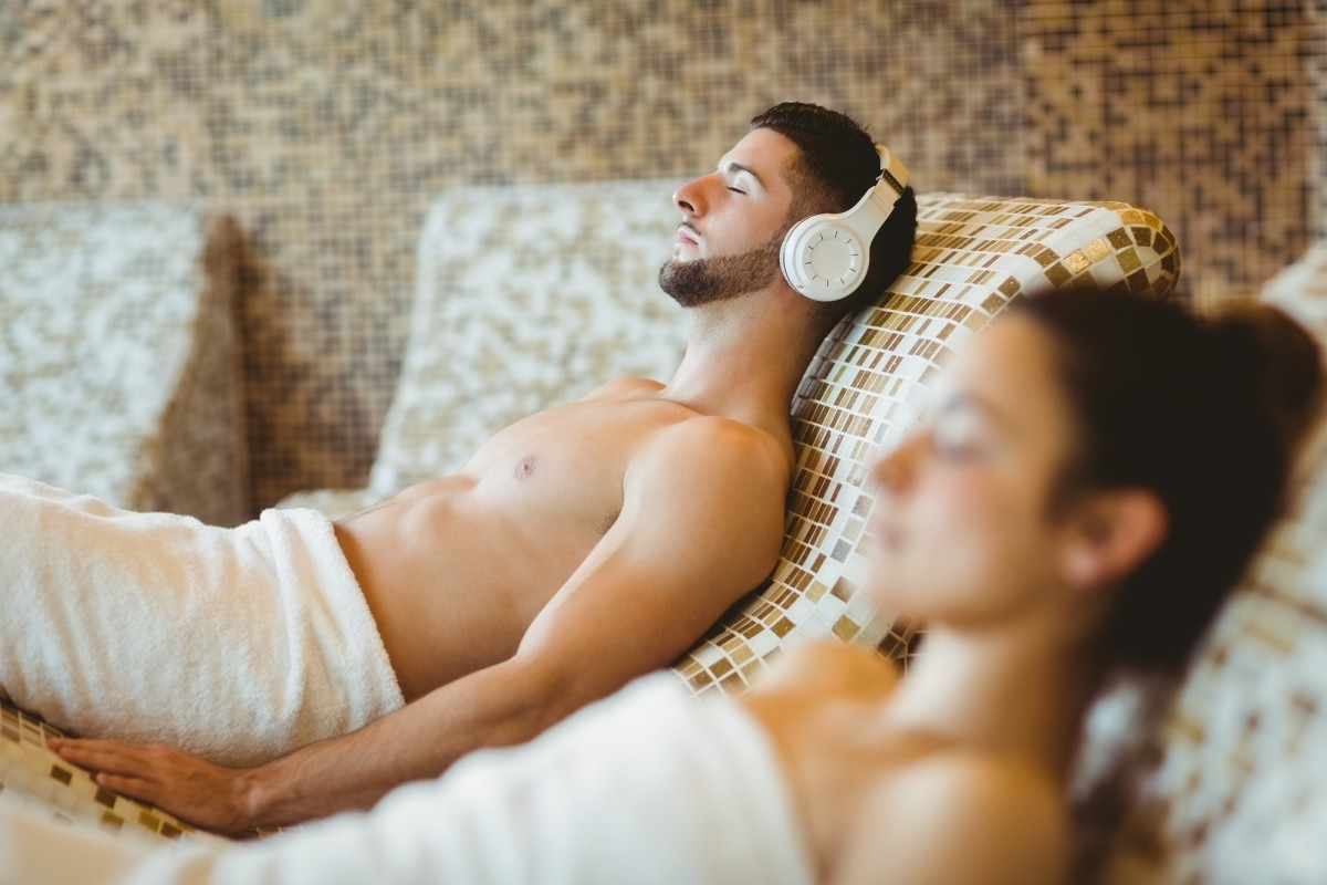 Man and woman lying down together at the spa