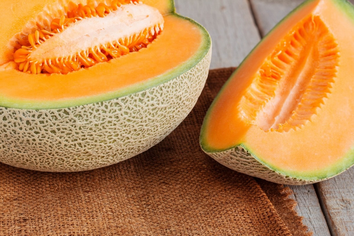 21 Invigorating Spa Water Recipes For Instant Energy; Melon sliced on wooden