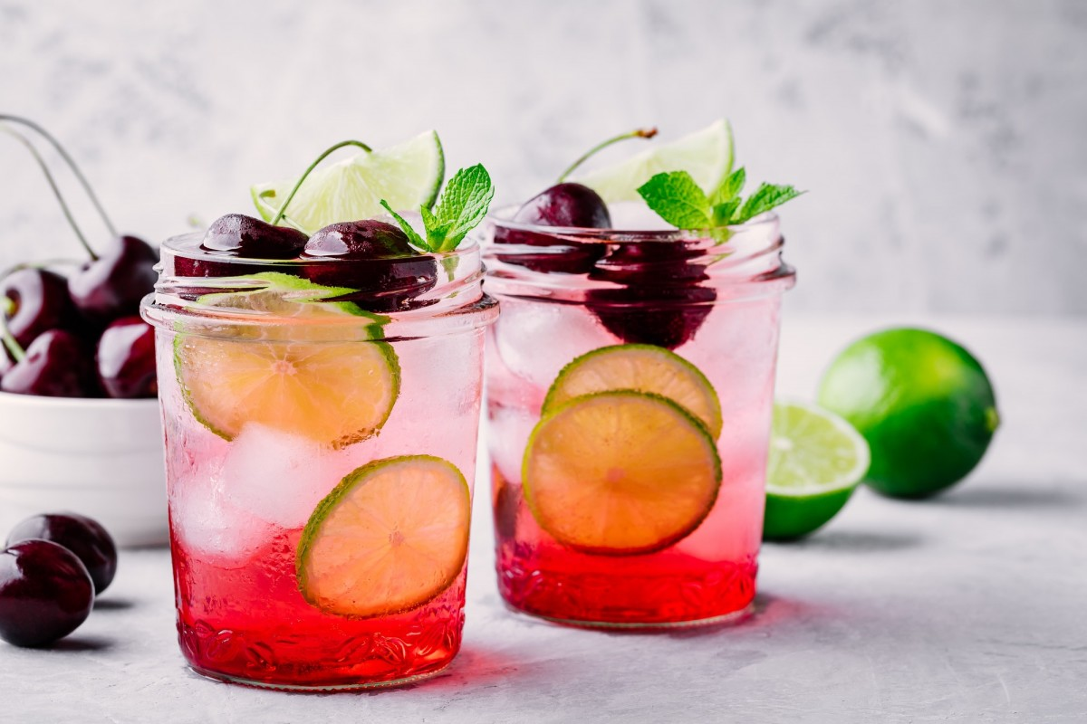 21 Invigorating Spa Water Recipes For Instant Energy; Refreshing cold summer drink cherry and lime lemonade