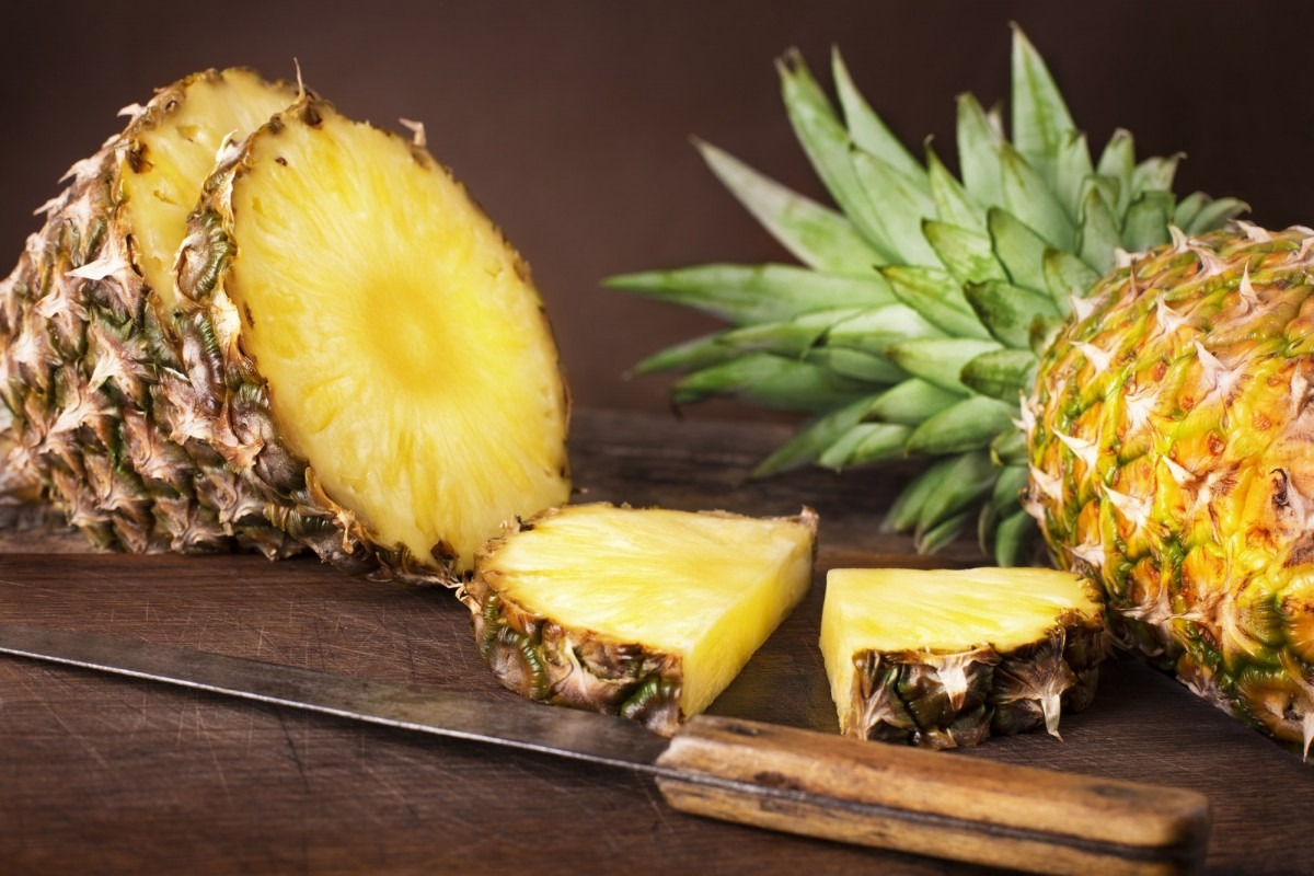 21 Invigorating Spa Water Recipes For Instant Energy; Slices of fresh pineapple