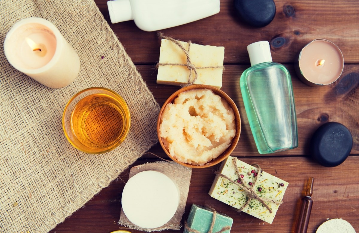 This DIY Spa Night Routine Will Give You A Youthful Glow; close up of body care cosmetic products on wood