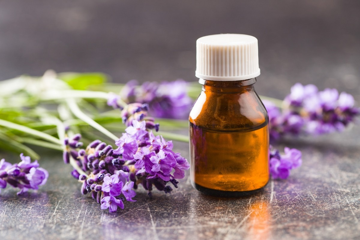 This DIY Spa Night Routine Will Give You A Youthful Glow; Essential oil and lavender flowers.