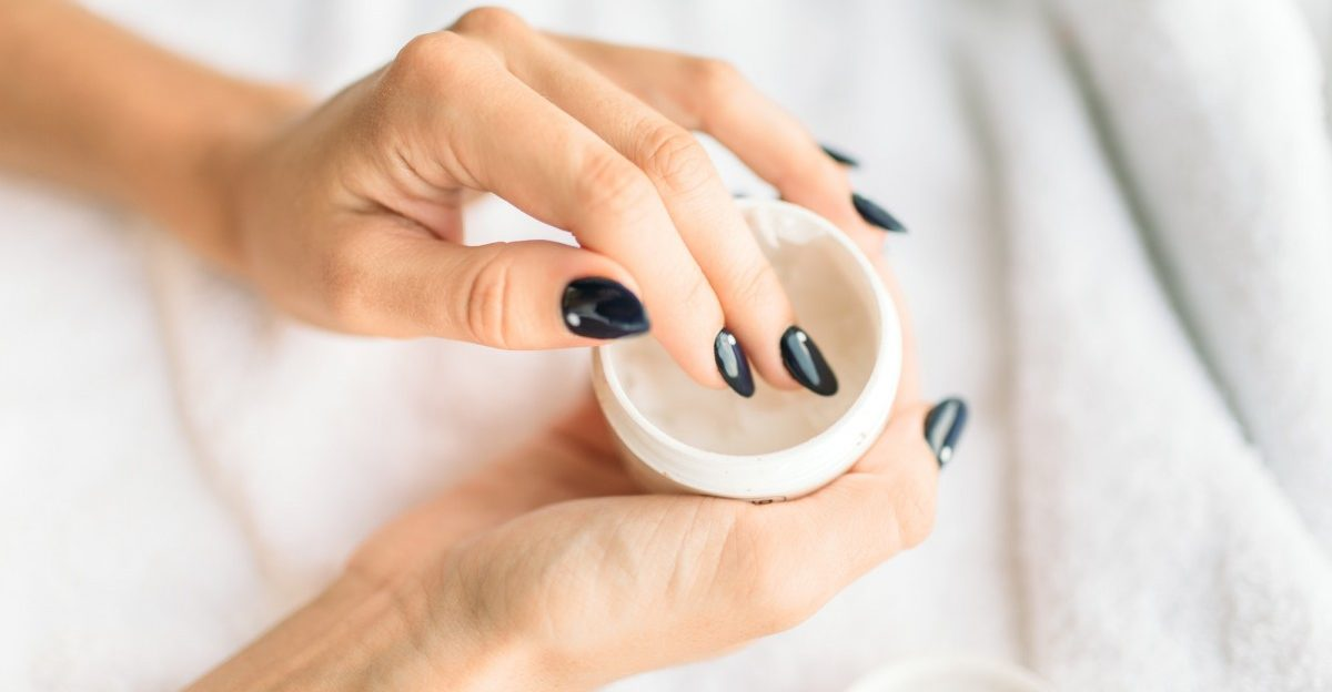 25 Toxic Skincare Ingredients To Avoid In Your Own Cosmetics; Female person hands with beauty product closeup