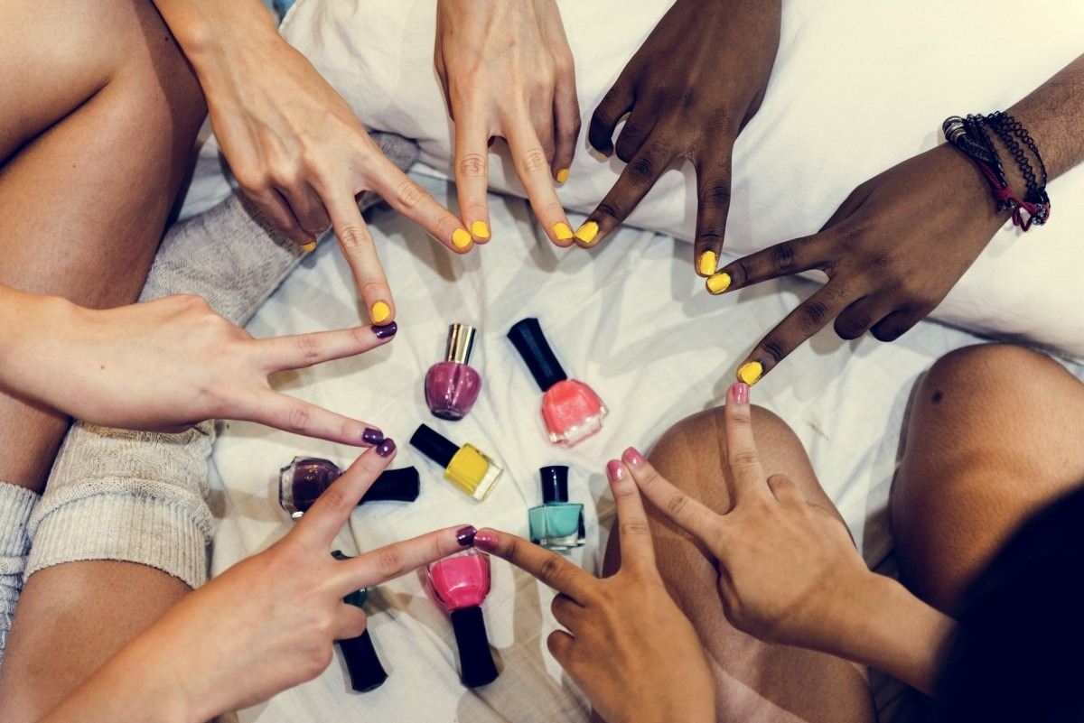 15 Best Non Toxic Nail Polish (Natural, Vegan, Chemical Free); Group of diverse women painting their nails