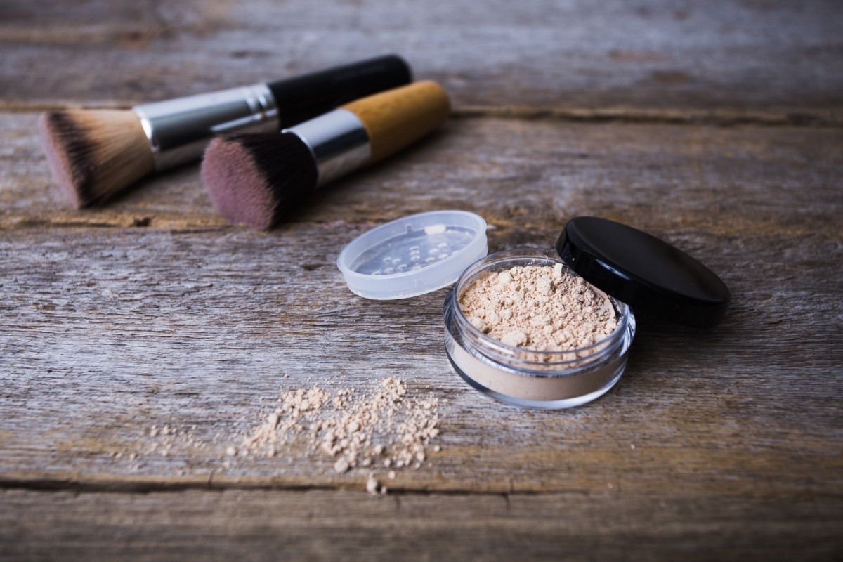 25 Toxic Skincare Ingredients To Avoid In Your Own Cosmetics; mineral powder of different colors with a brush for make-up on wooden background