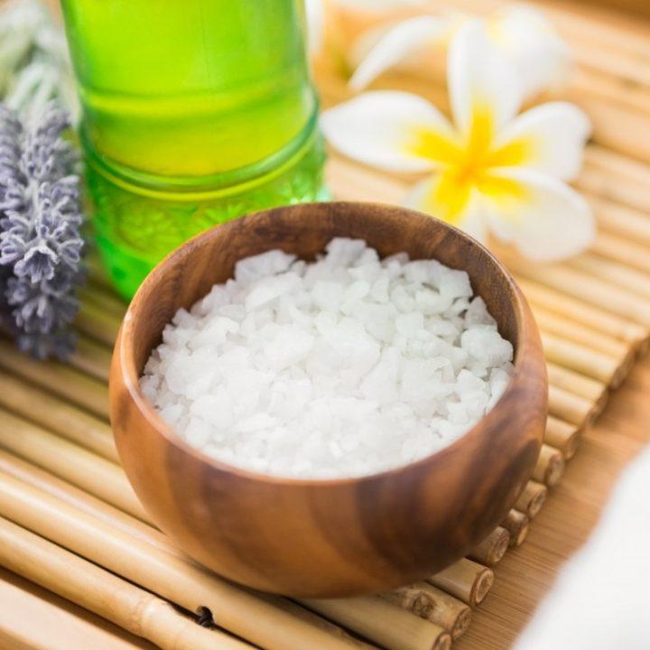 Salt scrub and oil massage on a bamboo mat
