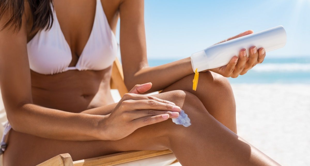 25 Toxic Skincare Ingredients To Avoid In Your Own Cosmetics; Woman applying sun screen